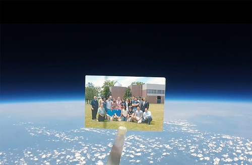 STEM students and faculty attached a photograph of themselves to the high altitude balloon.